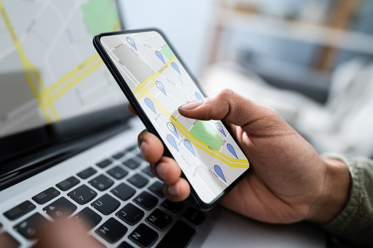 Person Using GPS Navigation Map On Mobile Phone