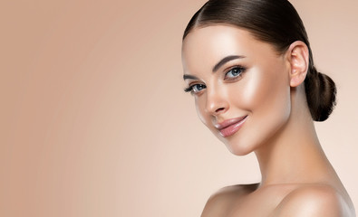 Fototapeta Beautiful young woman with clean fresh skin on face . Girl facial  treatment   . Cosmetology , beauty  and spa . obraz