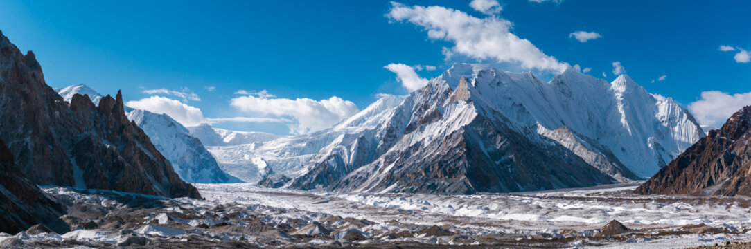 Panoramic view of Upper Baltoro Glacier with Vigne Peak in the middle and Chogolisa Peak, Snow Peak, Baltoro Kangri in background, from Concordia, Pakistan