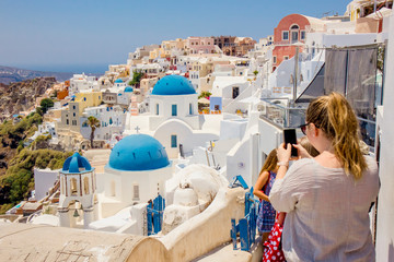 Foto auf Acrylglas Santorini Famous blue dome orthodox church in village of Oia on Santorini island in Greece in Europe.