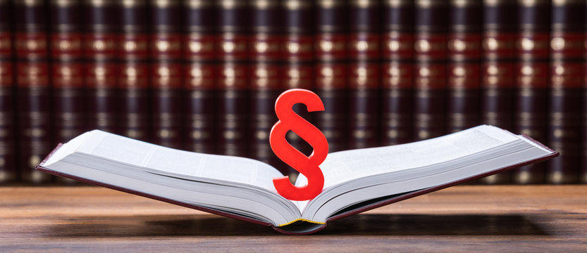 Close-up Of Paragraph On Open Law Book