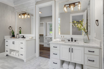 Beautiful bathroom in new luxury home with two vanities, sinks, and mirrors.