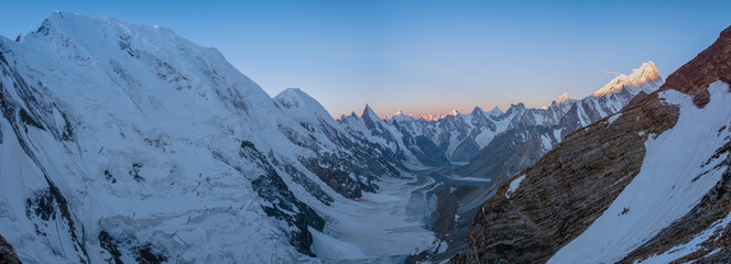Panoramic sunrise view of Laila Peak range and Kuispang Camp on the top of Gondogoro La with Biarchedi Peak in right side, Pakistan