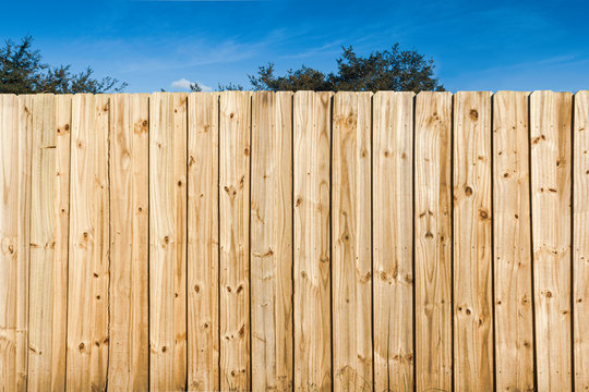 Pine wooden fence close up background