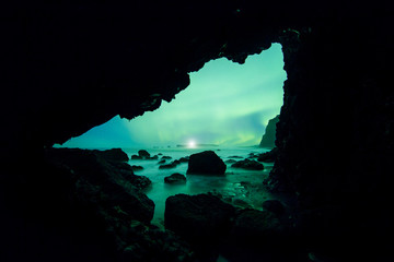Wall Mural - Aurora Borealis (Northern Lights) from an ocean cave
