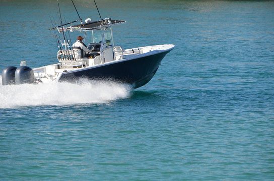 Sport fishing boat powered by two outboard engines
