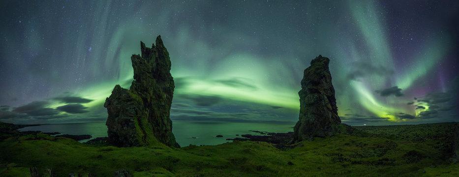 Aurora Borealis (Northern Lights) above rocks
