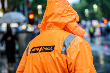 Melbourne, Victoria, Australia, January 10, 2020: A Yarra Trams worker watches a street protest was held in the city protesting against the Prime Minister Scott Morrison