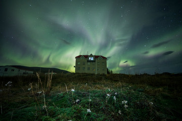 Wall Mural - Aurora Borealis (Northern Lights) above a haunted house