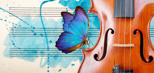 Butterfly, violin and notes. Blue morpho butterfly and violin. Melody concept. Photo of old music...