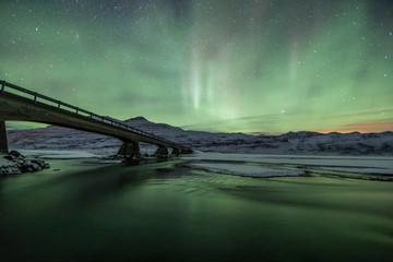 Wall Mural - Northern Lights (Aurora Borealis) abovea bridge in the snow