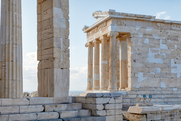 View of the ruins of Parthenon temple. Acropolis Hill in Athens. The surviving part of the colonnade. Monument of ancient architecture. Blue sky. Traveling and vacation concept.