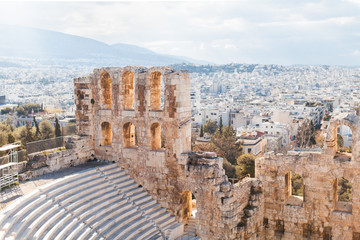 View of the ruins of Parthenon temple. City on the background. Acropolis Hill in Athens. The surviving part of building. Monument of ancient architecture. Blue sky. Traveling and vacation concept. Fototapete