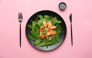 Fotobehang - Plate with tasty salad on color background
