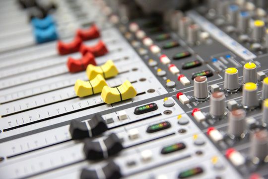 Close up Volume adjustment slides on sound audio mixer and av equipment in Studio room for recordind,sound editor,audition and entertainment events.