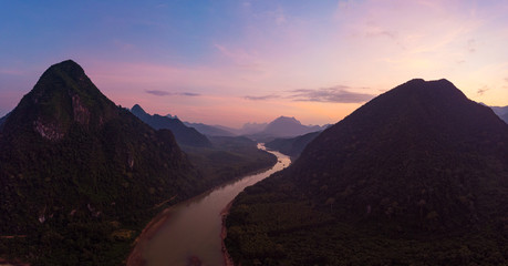Zelfklevend Fotobehang Chocoladebruin Aerial panoramic Nam Ou River Nong Khiaw Muang Ngoi Laos, sunset dramatic sky, scenic mountain landscape, famous travel destination in South East Asia