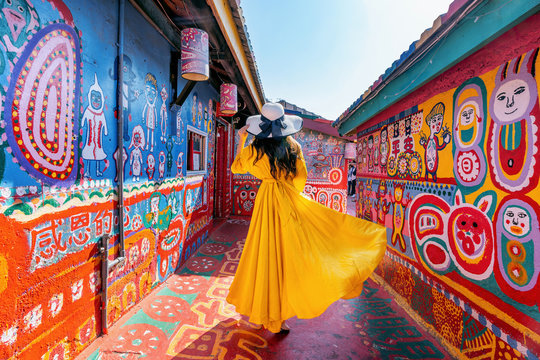 Woman standing at Rainbow village in Taichung, Taiwan.