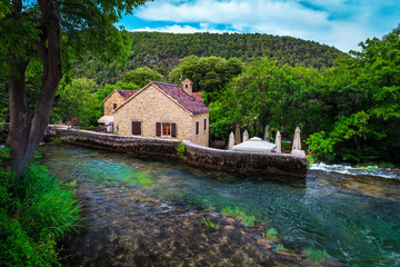 Wall Mural - Krka National Park with gurgle brook, cascades, Sibenik, Dalmatia, Croatia