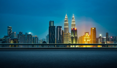 Deurstickers Kuala Lumpur Empty asphalt road with beautiful night cityscape scene .