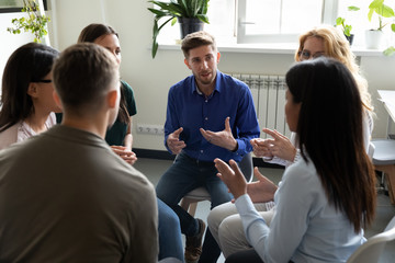 Papiers peints Kiev Diverse people seated in circle participating at group therapy session
