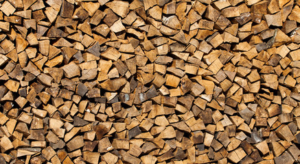Tuinposter Brandhout textuur pile of cut wood for fire