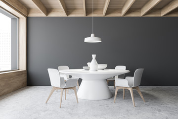 Gray dining room interior with round table