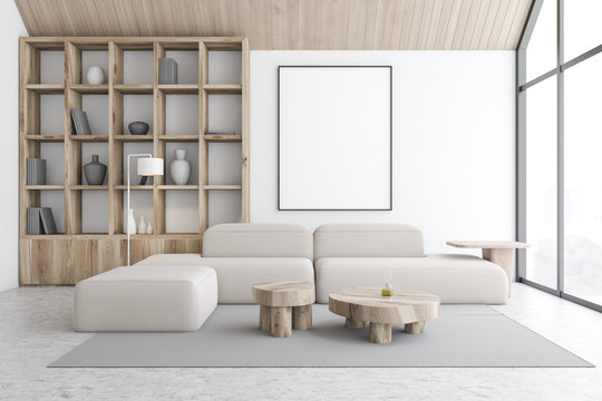 White attic living room and library with poster