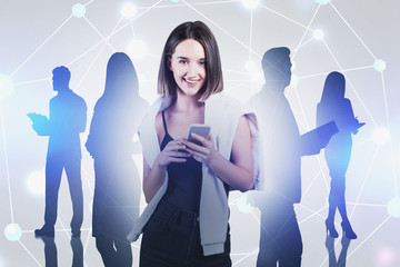 Fotobehang - Smiling woman with phone and her team, network