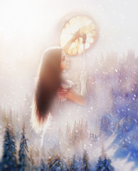 vision of beautiful shamanic girl in snowy mountain landscape.
