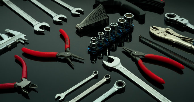 Set of mechanic tools. Chrome wrenches or spanners, hexagon socket, end cutter pliers, locking pliers, vernier caliper, pincers, feeler gauge, and tape measure. Chrome vanadium spanner wrench.