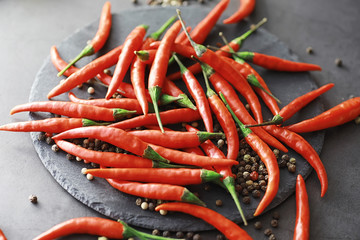 Aluminium Prints Hot chili peppers Hot red pepper. Chilean pepper on a black.