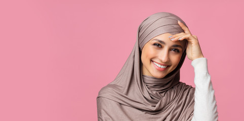 Shy muslim woman in hijab feeling embarrassed and blush after compliment