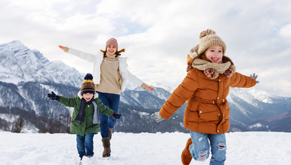 happy family mother and children having fun on winter walk