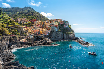 Fototapeten Ligurien Manarola village viewed from the harbor facing to the sunlight. Cinque Terre National parc in the Northwest of Italy.