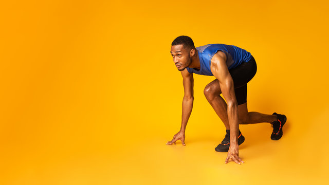 Confident afro guy preparing for a run at studio