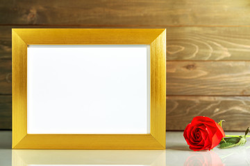 Picture mock up with golden frame on table with copy space