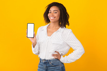 Smiling afro woman showing new app on phone