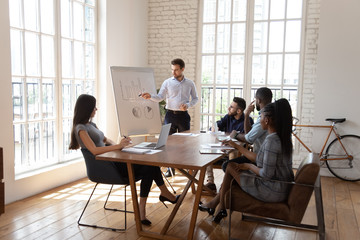 Male coach make whiteboard office presentation to diverse employees