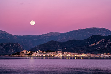 Keuken foto achterwand Candy roze Full moon rising over St Florent in Corsica
