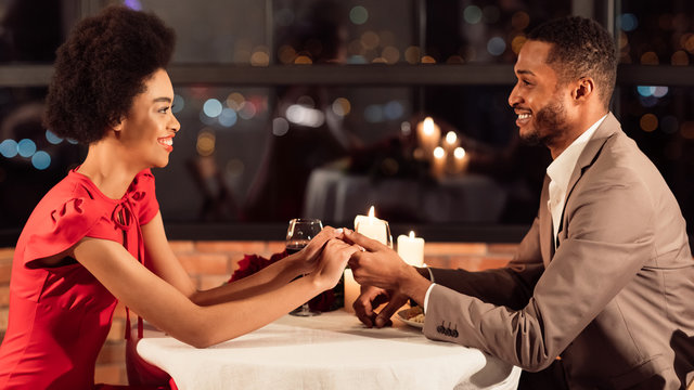 African American Spouses Holding Hands Having Dinner In Restaurant, Panorama