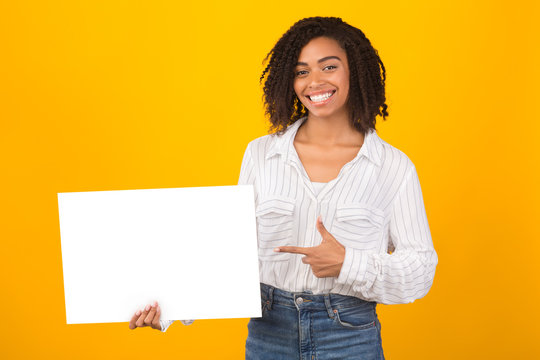 African american girl pointing at white paper