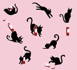 Black cats with bottles of red wine