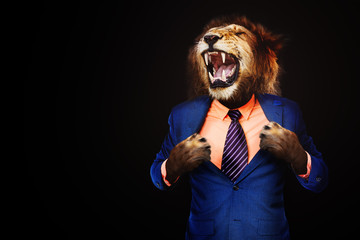 Poster Lion Furious angry businessman with face of lion roar
