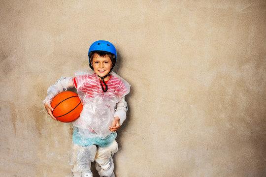 Kid and basketball ball overprotecting bubble wrap