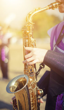 Young student Musician playing the Saxophone with Music practice of Band, Musical concept