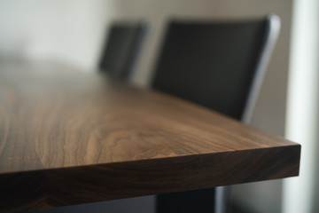 Closeup shot of walnut dining table