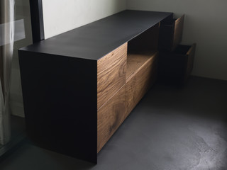 modern tv stand made from walnut and powder coated steel