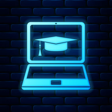 Glowing neon Graduation cap and laptop icon isolated on brick wall background. Online learning or e-learning concept icon. Vector Illustration