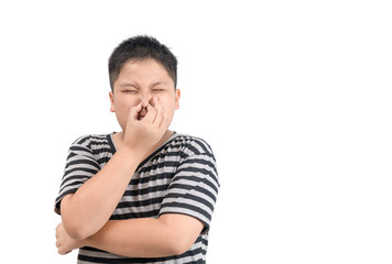 Obese boy holding his nose because of a bad smell