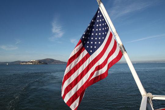 Usa flag on sea and The alcatraz island at San francisco,USA